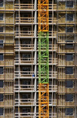 Large building under construction with scaffold photo