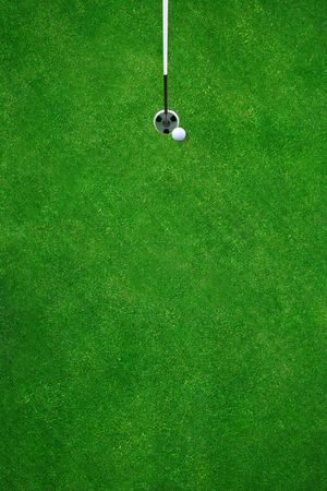 Golfball almost in the hole on a beautiful golf course - top view Stock Photo - 430936