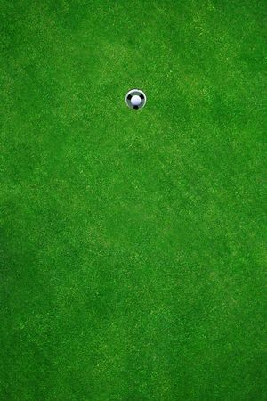 Golfball in golfhole after a perfect put Stock Photo - 430929