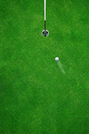 Golfball on its way to the hole on a beautiful green Stock Photo - 430932