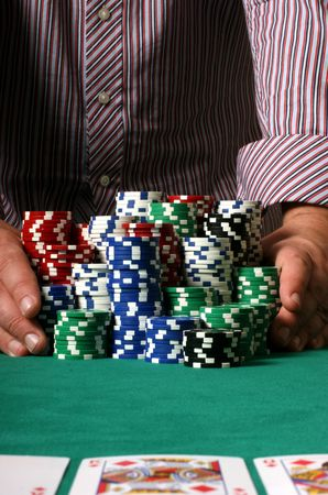 poker table: Professional poker player betting everything on one hand
