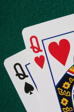 hold'em: Close up of pocket QQ - a very strong hand in texas holdem poker