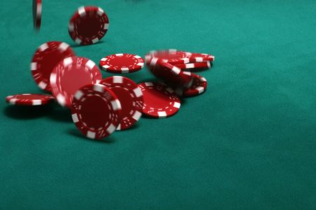 Chips being tossed onto the pokertable photo