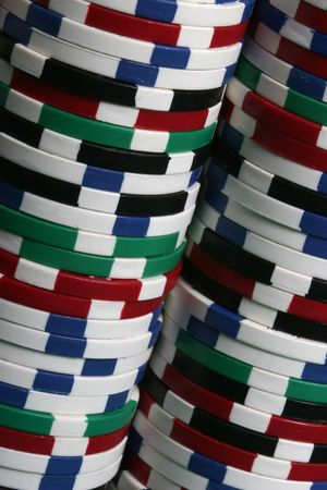 Multi colored poker chips seen up close photo