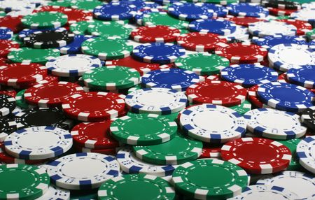 Huge poker pot containing all kinds of chips photo
