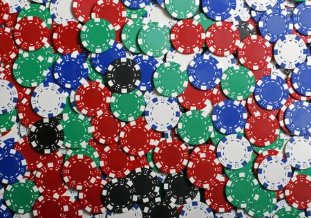 Casino poker chips of all colors and value photo