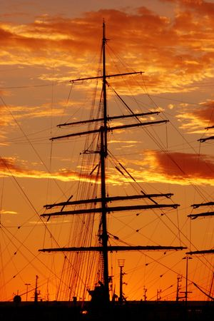 Silhouette of a schooner against the sunset photo