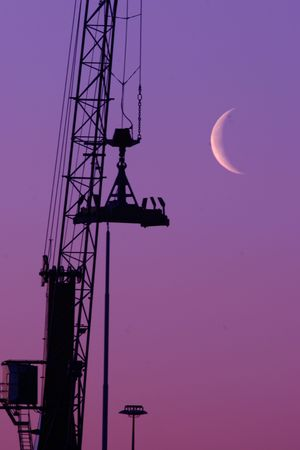 Shipyard crane against the moonlight - with plenty of copy space photo
