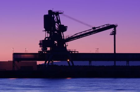 Crane silhoette with a beautiful backdrop sunset photo