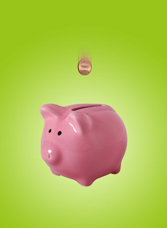 Pink piggybank made of ceramic isolated on green with clipping path photo