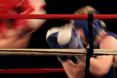 Boxing match with motion blurred boxers photo