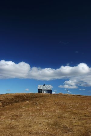 Isolated house on a hill in the countryside photo