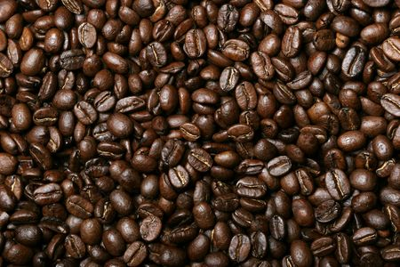 Background of delicious freshly roasted coffee beans photo