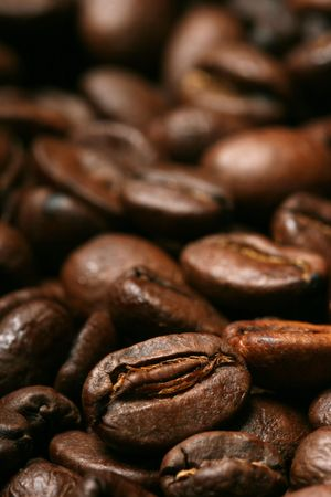 Close-up of delicious freshly roasted coffee beans photo