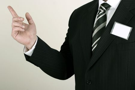 nametag: Business man at a convention with a blank nametag - insert your own brand or information