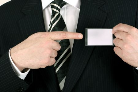 Business man showing his blank namebadge - insert your own brand and information photo