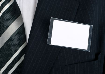 Blank namebadge on a well dressed businessman - insert your own brand and information Stock Photo - 858092