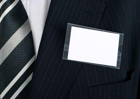 Puste namebadge na dobrze ubrany biznesmen - wstawić własną markę i informacje