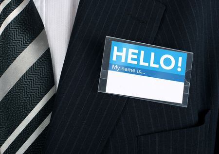tradeshow: Namebadge saying hello on a well dressed businessman - insert your own information Stock Photo