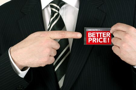 Sales person pointing to a badge offering a special price Stock Photo - 881683