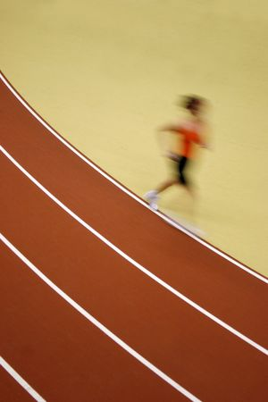 Motion blurred runner way ahead the competition - some grain visible Stock Photo