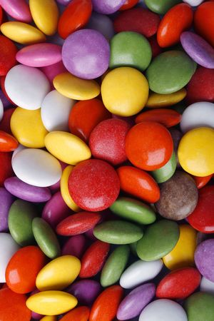 Close-up background of multi colored smarties candy