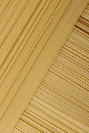 lined up: Fresh spaghetti lined up and overlapping at a perfect angle Stock Photo