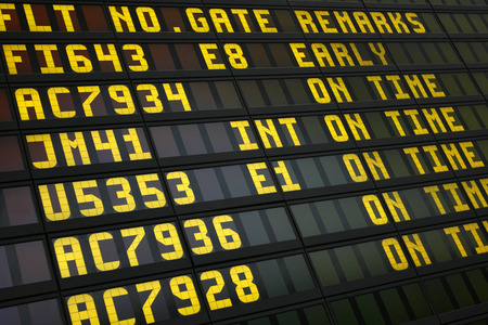 departures: Airport board showing arrivals and departures on time Editorial