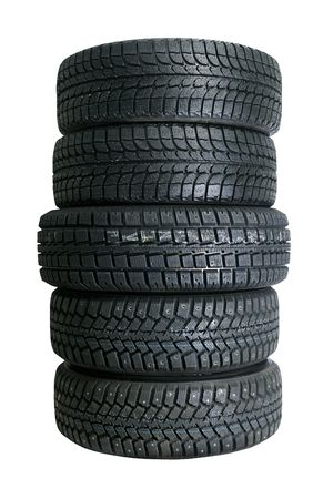 Brand new tires stacked up and isolated on white background Stock Photo