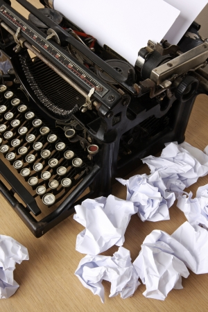 writers: Retro typewriter with paper scattered all around - conceptual image for creative block