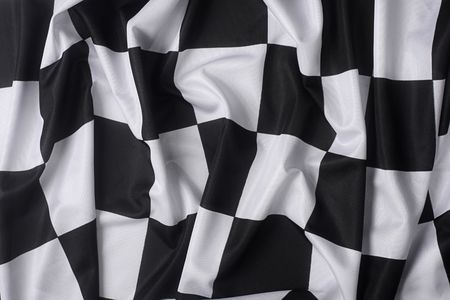 This is a real checkered flag of high quality - texture details in the material Stock Photo