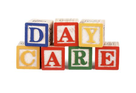 block letters: Alphabet blocks lined up to spell the word daycare isolated on white