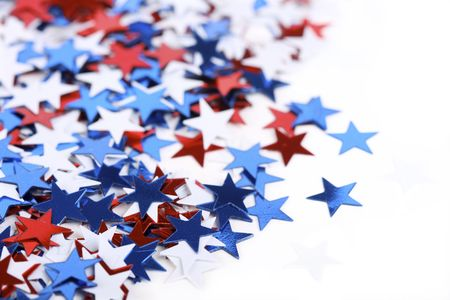 usa patriotic: Star shaped confetti - perfect as a election or 4th of july background - focus on stars in front
