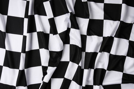 This is a real checkered flag of high quality - texture details in the material Stock Photo - 2610997