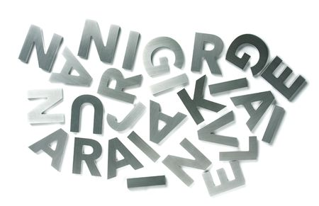 Stylish letters cut out of polished steel isolated on white Stock Photo