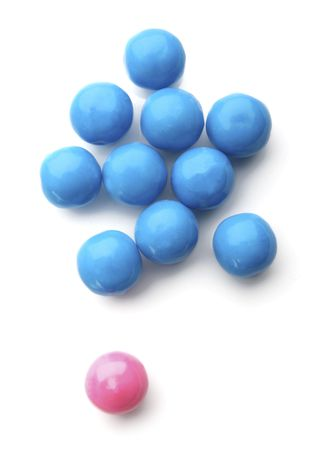 gumball: pink and blue bubble gum balls isolated on white - concept for females versus males and  discrimination