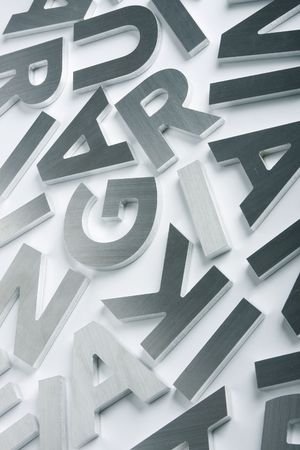 sans: Stylish letters cut out of polished steel