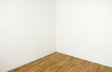wooden insert: Blank white wall in a clean room with wooden floor - insert your own design on the wall
