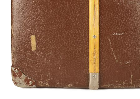 Close-up of an old and worn leather suitcase  photo