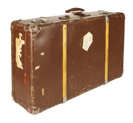 Old and worn retro suitcase isolated on white background photo