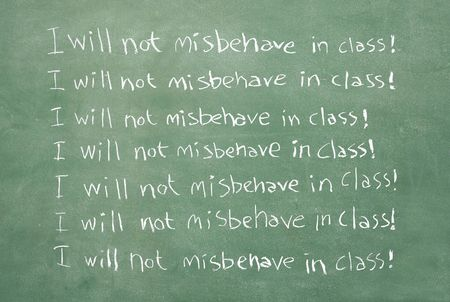 misbehave: large XXL image of an old chalkboard with the sentence I will not misbehave in class written over and over again Stock Photo