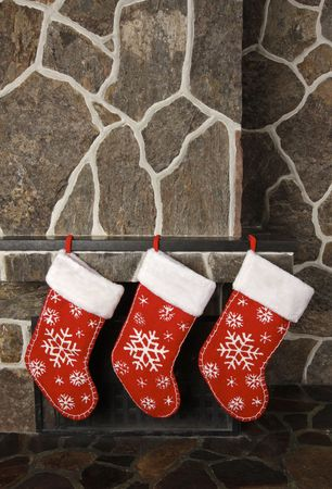 stocking: Christmas stockings on a fireplace mantel