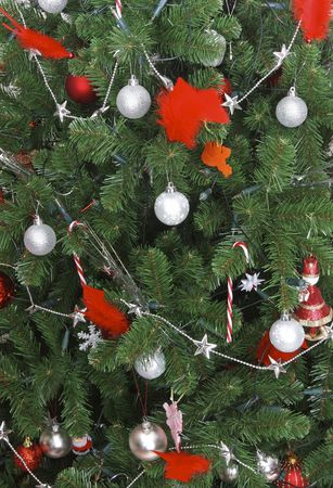 lavish: Close-up of a beautiful christmas tree with lavish ornaments