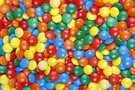 Close-up background of multi colored chocolate candy Standard-Bild