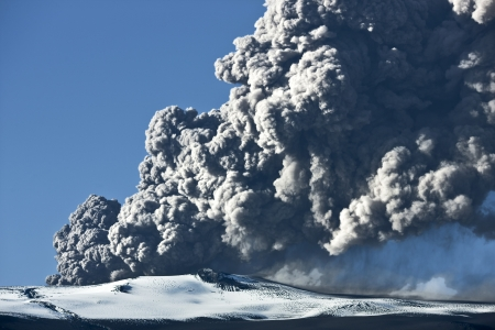 Ash cloud rising from the Eyjafjallajokull volcano in Iceland photo