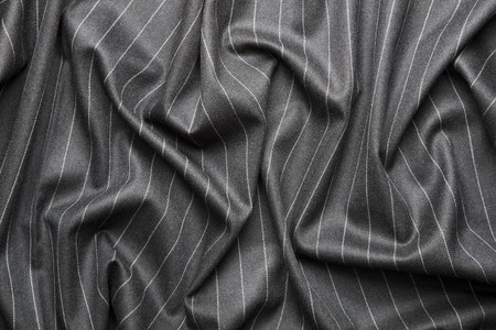 High quality pin stripe suit background texture with folds