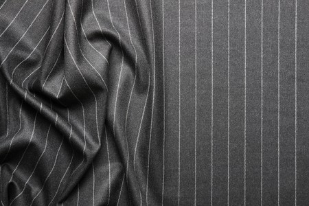 High quality pin stripe suit background texture with folds and copy space