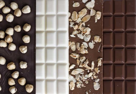 Four different flavors of chocolate bars photo