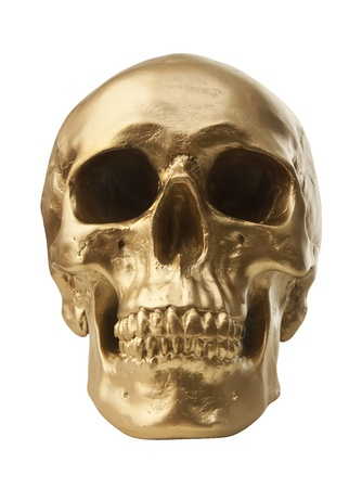 Golden human skull isolated on white background photo