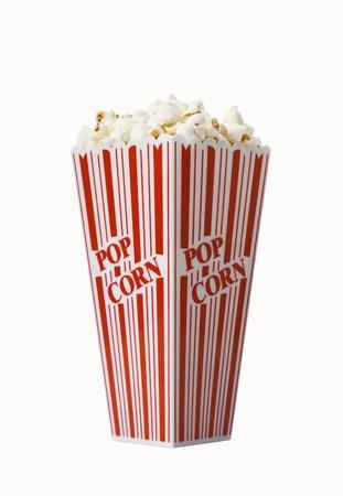 Box of fresh popcorn isolated on white background photo
